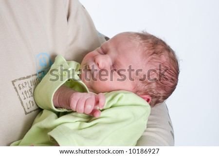 newborn baby in the arms of his dad