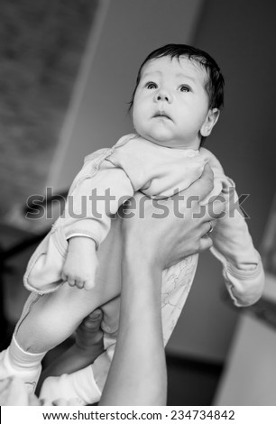 Newborn baby in the arms of his mother ( black and white )