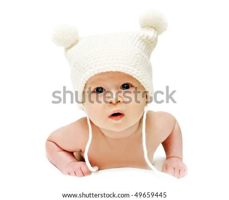Newborn baby in the cap isolated - stock photo