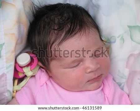 Newborn Baby Infant Napping wearing Pink Shirt - stock photo
