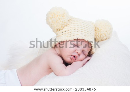 Newborn baby is sleeping on a fluffy blanket - stock photo