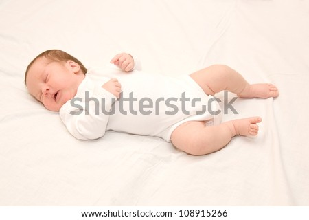 Newborn baby is sleeping soundly and peacefully - stock photo