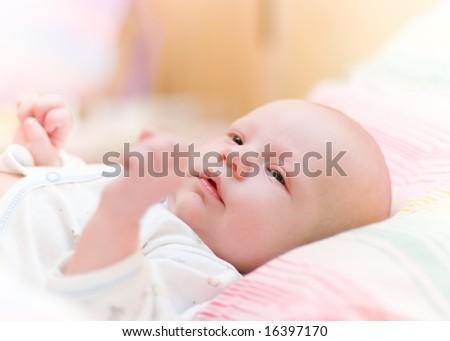 Newborn baby lie in cradle - stock photo