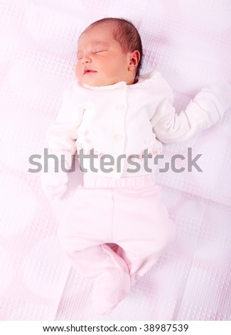 Newborn baby on white background. Beauty image - stock photo
