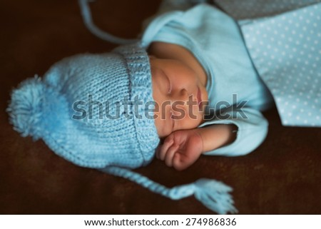 Newborn baby peacefully resting / Close up photo from a newcomer indoor People / Beauty/Fashion - stock photo