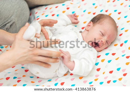 Newborn baby screaming in pain with colic - stock photo