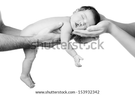 Newborn baby sleeping on parents hands, on white background. Black and White. - stock photo