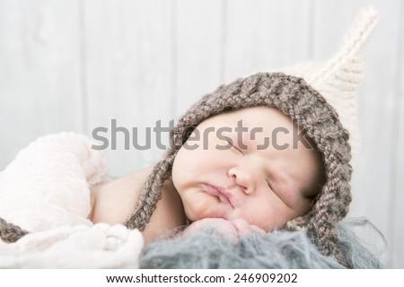 Newborn baby sleeping with hat - stock photo