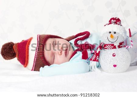 Newborn baby sleeping. Xmas team - stock photo