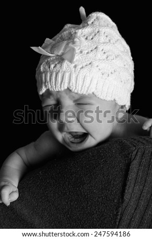Newborn baby wearing a hat - stock photo