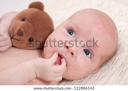 Newborn baby with toy - stock photo
