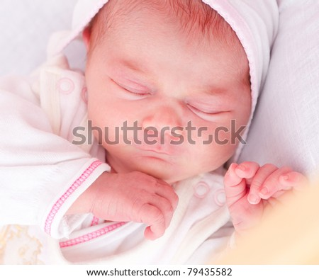 newborn, 10 days old  baby sleeping in baby crib