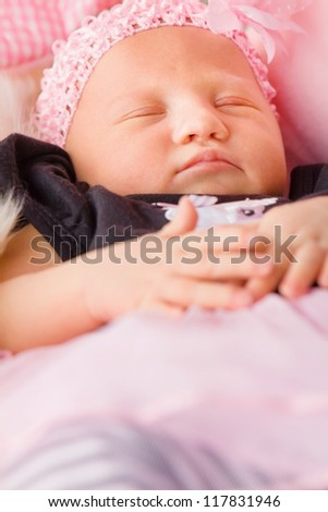 Newborn girl sleeping in blankets - stock photo