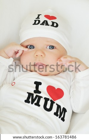 newborn girl wearing clothing with love to mum and dad (not trademark)