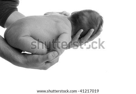 newborn in father's hand isolated on white background - stock photo