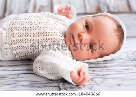 Newborn infant wearing nice homemade cap  - stock photo