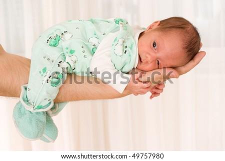 newborn lies on his hand - stock photo