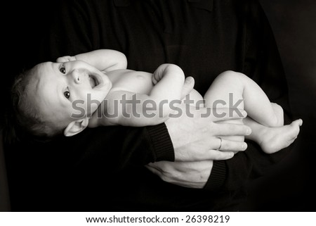 Newborn on hands at the daddy