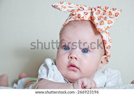 Newborn portrait with hat in retro style. - stock photo