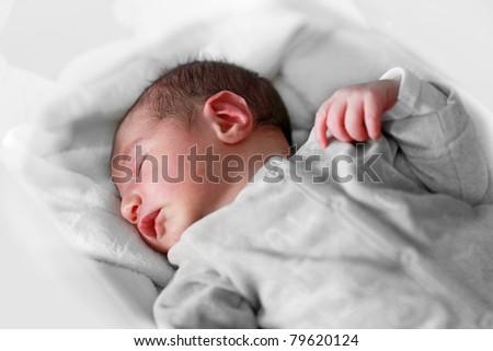 Newborn Sleeping: baby boy (one day old) closeup as he is sleeping peacefully - stock photo