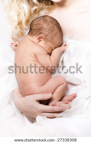 Newborn sleeping child in the hands of mother