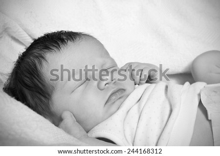 Newborn tiny toes and feet - stock photo