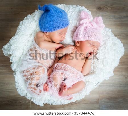 newborn twins - a boy and a girl sleeping - stock photo
