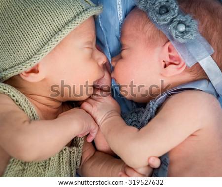 newborn twins - a boy and a girl sleeping on a blue blanket closeup - stock photo