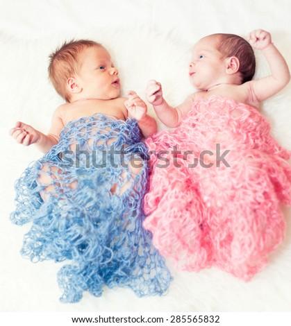 Newborn twins boy and girl - stock photo
