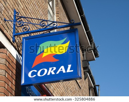 Newbury, Market Place, Berkshire, England - October 10, 2015: Coral bookmakers, British betting shop, bingo and casino operator owned by private equity firm Candover Investments - stock photo