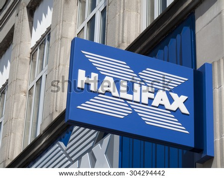 Newbury, Northbrook Street, Berkshire, England - August 07, 2015: Halifax bank sign over local branch office, bank founded as a Building Society in 1853 - stock photo