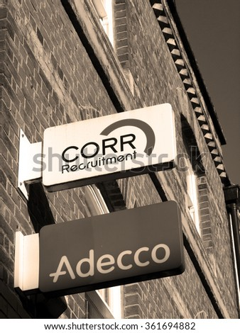 Newbury, Northbrook Street, Berkshire, England - October 10, 2015: CORR Recruitment and Adecco Recruitment company signs outside offices over retail units - stock photo