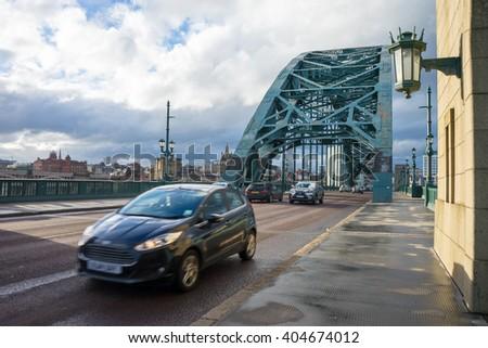 NEWCASTLE, ENGLAND - MARCH 27, 2016: Tyne Bridge, Newcastle/Gateshead. Bridge spanning River Tyne.  Cars are driving over the bridge, a slight bit of motion blur has been used to show movement. - stock photo
