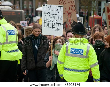 NEWCASTLE, UK - DEC 9: UK university and college students protest against increase in tuition fees and education cuts on the day of vote in the Parliament on December 9, 2010 in Newcastle. - stock photo