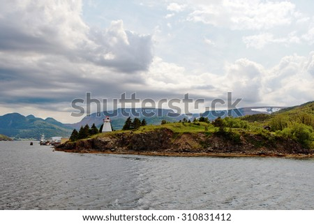 Newfoundland Lighthouse on a cloudy day. - stock photo