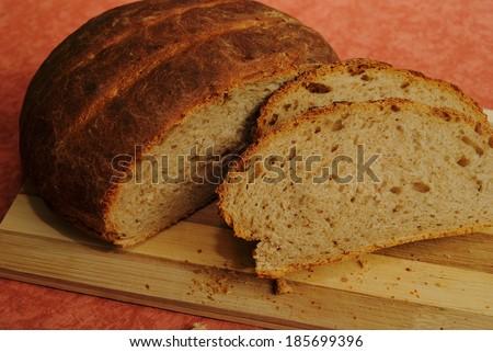 newly-baked rural gray bread - stock photo