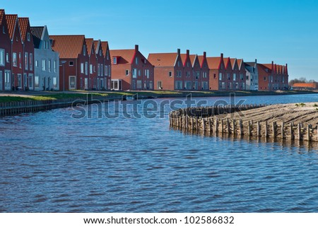 Newly built homes in project Meerstad in the Netherlands unless financial crisis - stock photo