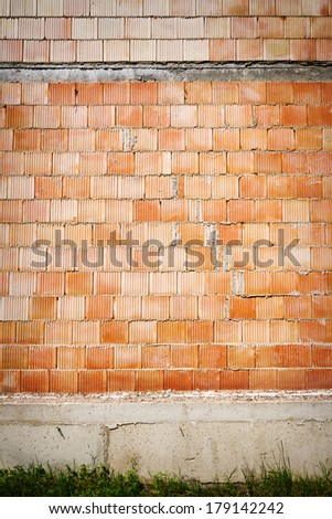 Newly built red block wall - stock photo