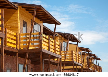 Newly built two-storeyed wooden and brick town house - stock photo