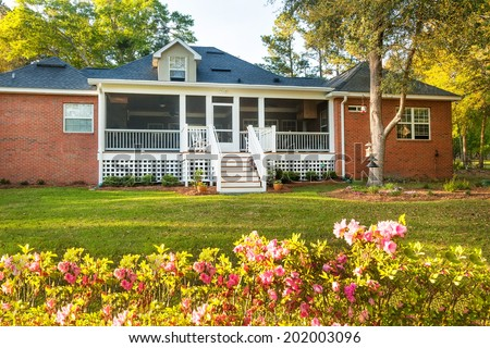 Newly constructed backyard deck at residential house - stock photo