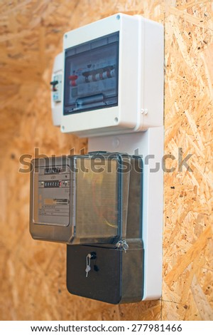 Newly installed electricity meter on the wall. - stock photo