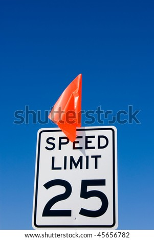 Newly installed 25 mph speed limit sign with red flag - stock photo