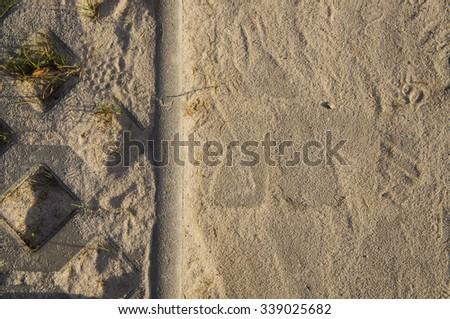 newly laid interlocking pavement pavage paving concrete grey structure white sand - stock photo