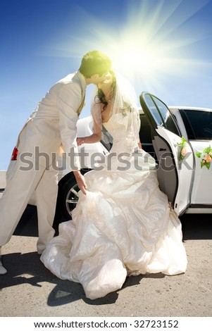 Newly-married couple and a kiss - stock photo