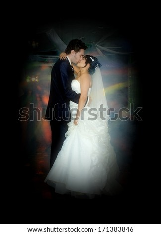 Newly married couple dancing a slow dance - stock photo
