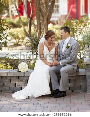 newly married couple having private moment in the garden - stock photo