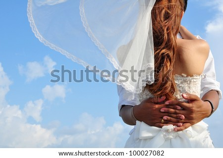 Newly married couple on the ocean - stock photo