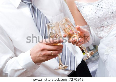 Newly-married couple with full glasses - stock photo