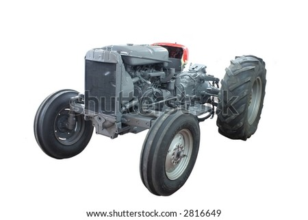 Newly painted tractor isolated on white - stock photo