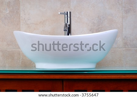 Newly Renovated Bathroom With A Modern Faucet And Vanity Bowl - stock photo
